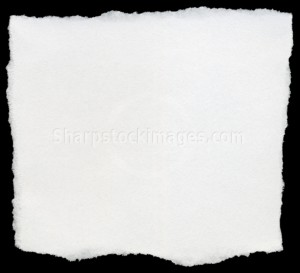 White torn square of paper isolated on a black background.